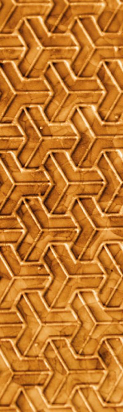 Nahaufnahme von goldfarbigem EPP. Das Muster besteht aus verschachtelten T-förmigen Elementen.